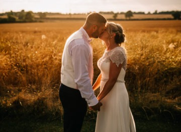 bride and groom by a corn field at Sywell Grange wedding venue