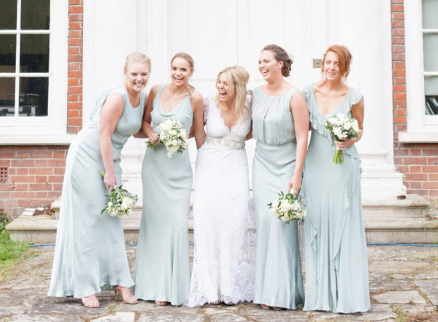 bride and her bridesmaids wearing mint green dresses