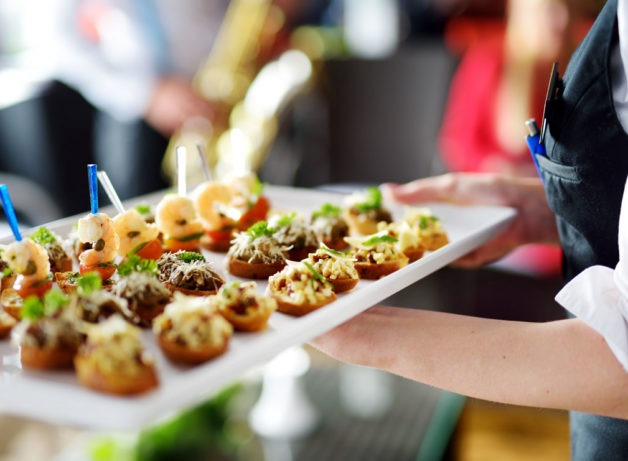 wedding canapés being served at a wedding